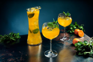 Mint & Mandarin   glasses with orange drink and mint